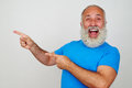 Bearded male gesturing happiness and pointing with fingers to hi Royalty Free Stock Photo