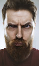 Bearded male making funny silly face man Royalty Free Stock Images