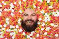 Bearded man in candies