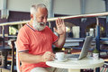 Bearded man having video chat cheerful drinking coffee and with someone on the internet Stock Photography