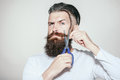 Bearded man with scissors Royalty Free Stock Photo