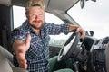 Bearded man sitting in a car cabin