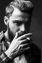 Bearded man smoking. Royalty Free Stock Photo