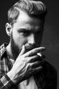 Bearded man smoking. Royalty Free Stock Photo