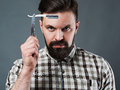 Bearded man with straight razor Royalty Free Stock Photo
