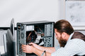 Bearded repairman disassembling computer unit Royalty Free Stock Photo