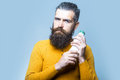 Bearded serious man with milk bottle Royalty Free Stock Photo