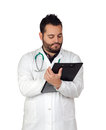 Bearded young doctor with a clipboard isolated on white background Royalty Free Stock Photo