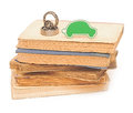 Bearings with small car on pile books Stock Photo