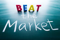 Beat the market conceptual words on blackboard Stock Photo