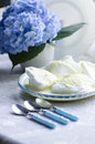 Beaten egg whites with butter cream and hydrangea blurred background next three teaspoons Royalty Free Stock Images
