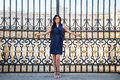 Beatiful brunette woman portrait at a palace's gate Royalty Free Stock Photo