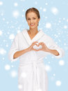 Beatiful woman with heart shaped hands health spa beauty and happiness concept beautiful in white bathrobe Stock Photo