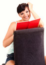 Beatiful woman is reading book white background Stock Photography