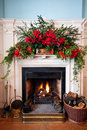 Beatifully decorated fireplace with lit fire Royalty Free Stock Photo