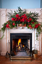 Beatifully decorated fireplace with lit fire Royalty Free Stock Photography