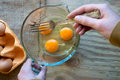 Beating eggs with fork getting ready to beat a Royalty Free Stock Image
