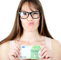 Beauitful woman holding some Euro currency note with funny look Royalty Free Stock Photo