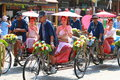 Beaultiful three wheeler parade thai girl with umbrella on in songkran festival Stock Images