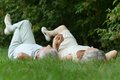 Beauteous old couple lying on the grass Stock Photo