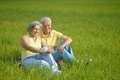 Beauteous old couple in the middle of the field Stock Image