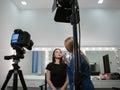 Beautician applying cosmetics to blogger Royalty Free Stock Photo