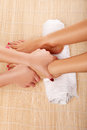 Beautician giving a foot massage Stock Photography