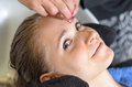 Beautician trimming a young girls eyebrows Royalty Free Stock Photo