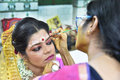 Beautician work bengali bride having make up applied by a Stock Photos