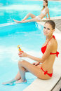 Beauties by the pool top view of two beautiful young women in bikini relaxing poolside Royalty Free Stock Photography