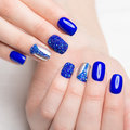 Beautifil blue manicure with rhinestone. Nail Design. Close-up Royalty Free Stock Photo