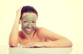Beautifu toplessl woman with facial mask. Royalty Free Stock Photo