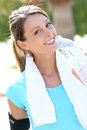 Beautiful active woman drinking water after jogging Royalty Free Stock Photo