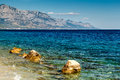 Beautiful adriatic beach near split and biokovo mountains in background croatia Stock Photography