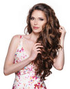 Beautiful adult woman with long brown curly hair fashion model over white background Royalty Free Stock Image