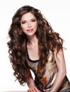 Beautiful adult woman with long brown curly hair fashion model over white background Stock Photos