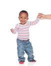 Beautiful african american baby learning to walk isolated on a white background Royalty Free Stock Image