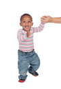 Beautiful african american baby learning to walk isolated on a white background Stock Photo