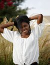 Beautiful african american girl portrait of smiling teenager on natural background Royalty Free Stock Photography