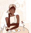 Beautiful african american girl in the street cafe Royalty Free Stock Photo