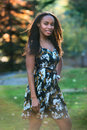 Beautiful african american smiling model woman walking in the city park Royalty Free Stock Photo