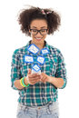 Beautiful african american teenage girl sending sms messages wit with mobile phone isolated on white background Stock Photos