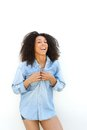 Beautiful african american woman laughing portrait of a young outdoors on white background Royalty Free Stock Photo