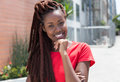 Beautiful african woman with dreadlocks in the city Royalty Free Stock Photo