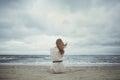 Beautiful alone girl on the beach Royalty Free Stock Photo