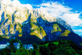 Beautiful alpine mountain landscape on summer day with little village in the valley Royalty Free Stock Photo