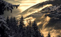 Beautiful alps the mountains in the fog in the rays of setting sun in french Stock Photography