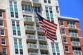 Beautiful American flag in front of modern apartment building Royalty Free Stock Photo