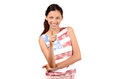 Beautiful american girl pointing in front to you attractive with usa flag on her blouse isolated on white focus on the model blur Stock Photography