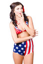 Beautiful american military pin up girl grunge style portrait of a smoking a durry with usa attitude Stock Photo